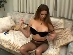 Long-haired milf enjoys pounding her vag with a dildo in solo clip