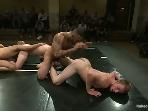 Four nude wrestlers fight in public and have gay sex
