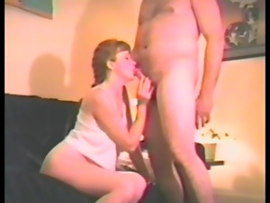 Delightful siren is sucking a cock with a dildo in her muff