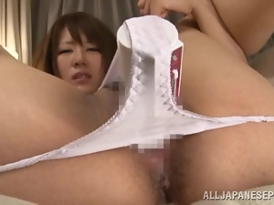 Adorable Japanese babe in white panties toys her vagina