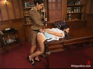 Kylee King sucks a strap-on and gets punished in an office