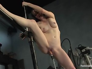 Brunette Scarlet Faux gets drilled by a machine deep