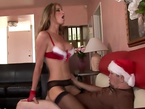 Sexy Santa girl Honey West gets fucked doggy style after giving head