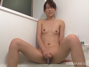 Asuka Hoshino gets caught masturbating her vag in a bathroom