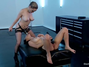 Raven Rockette gets toyed with electro strap-on by Aiden Starr