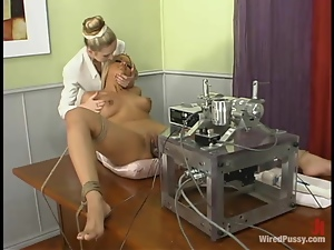 Smoking hot blond maid is under some machine penetration