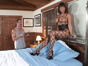 A hungry milf in fishnet bodysuit fucks hard