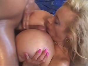 A very hungry milf with too huge tits is here to fuck