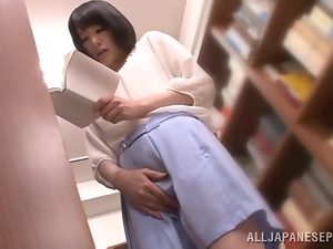 How about a stunning Japanese babe in a library