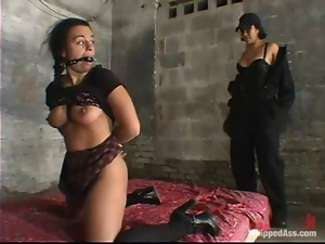 DragonLily fucks Jenya's mouth and pussy with a toy in a basement