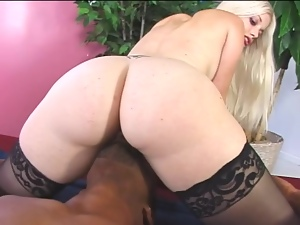 Innocent looking blond bunny enjoys a huge black cock
