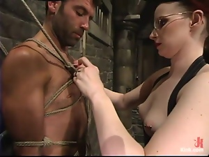 Redhead Claire Adams tortures guy's dick in a basement