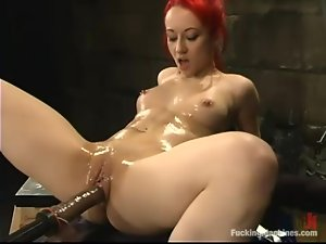 Nasty redhead chick gets toyed intensively by a machine