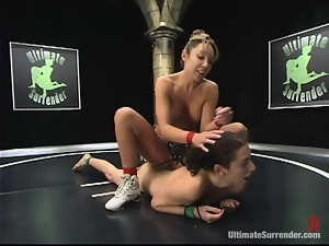 Slim brunette babes wrestle and then fuck using a strap-on