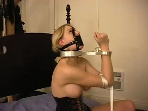Super hot and sexy blondie is belted and hogtied