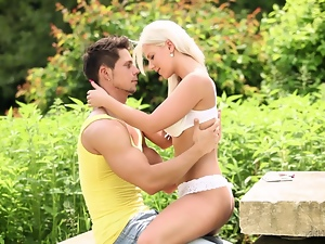Busty blonde babe Nathaly Cherie sucks and rides a dick in the garden