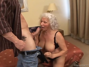 Filthy grandma is loving a huge cock in her mouth