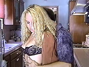 Two gorgeous chicks share a lucky dude's cock in homemade scene