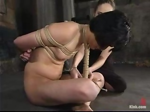 Scott Lee gets bound by some dominant milf in a basement