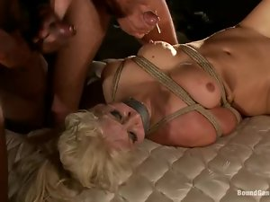 Bunch of black dudes are fucking a smoking hot blondie