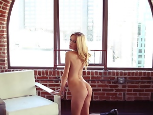 Slim Ally Game shows her nude body in an apartment