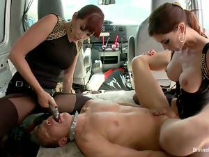 A dude gets tormented by two redhead mistresses in a minivan
