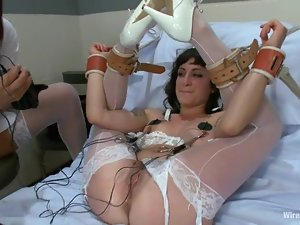 Naughty Nurses Enjoy a BDSM Lesbian Femdom Session with Toying and Strapon