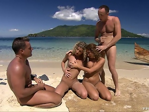 Group sex on the beach with two desirable babes