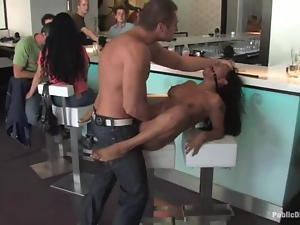 Gagged brunette chick rides a dick in some cafe