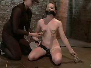 Honey is gagged and her tits are twitched so bad