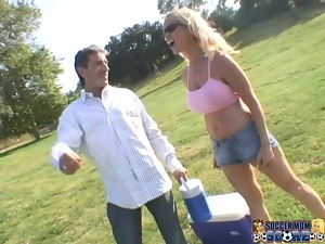 Gorgeous blond in mini skirt bends over to her boss