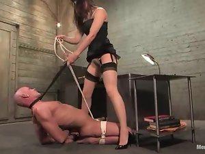 Charming brunette bondages her man and rides his cock