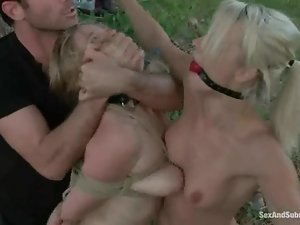 Two blonde girls get bounded and fucked outdoors
