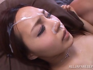 Beautiful Japanese cutie is being jizzed on her face