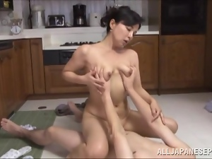 Desirable milf is having some wild sex in the kitchen