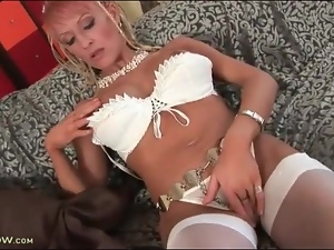 Fake tits of a hot milf licked and fondled