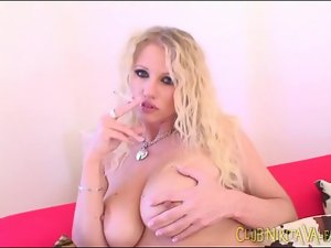 Nikita Valentin exposes big tits and smokes