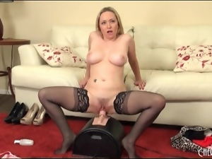 Big titty blonde in stockings rides Sybian