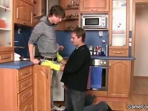 Gloved handjob and cocksucking in kitchen