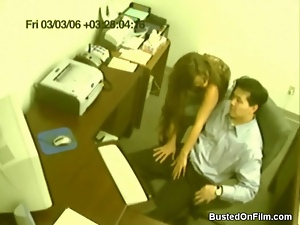 Secretary jerks off her boss in security cam