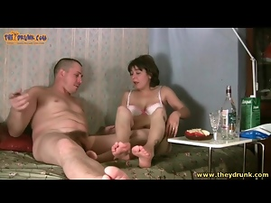 Naked guy and drunk babe throw back shots