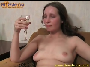 Champagne sipping girl masturbates her pussy