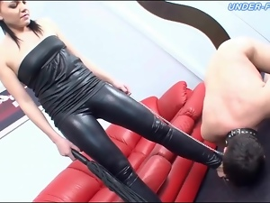 Submissive licks hot chick in leather all over