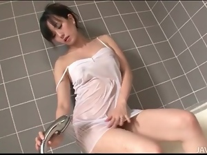 Japanese girl showers in her sexy slip