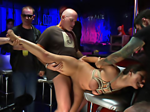 Tied girl fucked in a bar