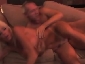 Blonde bimbo mature Melane Ann screwing on the couch