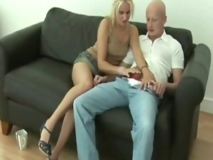 Blonde keeps her clothes on while sucking