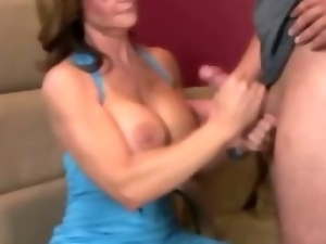 Horny MILF tugs cock and fingers herself