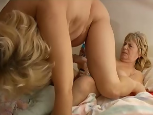 Two chubby mature hookers play with vaginal beads in lesbo scene