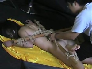 Tied Asian babe tormented